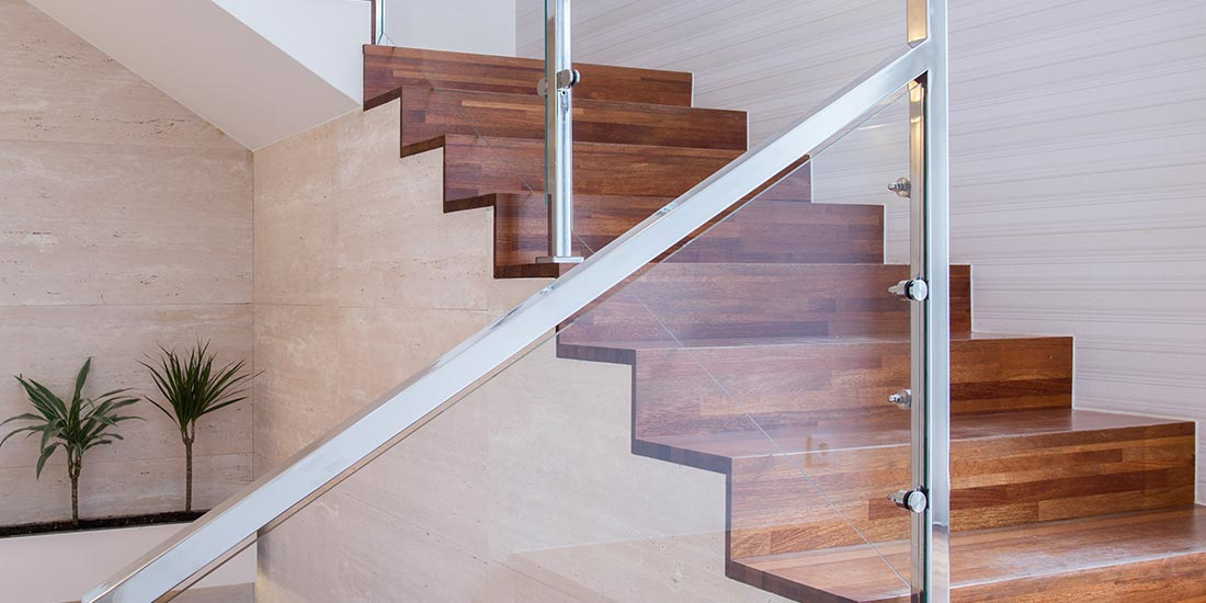 Staircase with metal frame glass balustrade